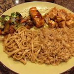 Fried rice, noodles, vegetables, salmon and chicken.