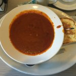 Tomato basil soup and grilled ham and cheese half sandwich
