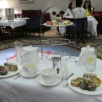 table setting with sandwiches and sweets