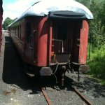 A dining and a coach car waiting to be restored.