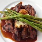 Bourbon steak tips with mash potatoes and asparagus