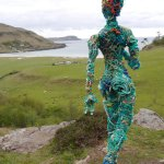 Figure looks out over Calgary Bay