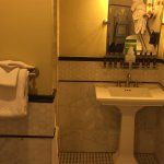 Shower has rounded bar for curtain. Beautiful tile work. Nice amenities.