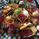 Supreme nacho platter with chicken