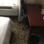 Room 502. 2.5ft between bed/desk forces chair between bed/AC unit. Poor layout.