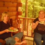 Friends enjoying cookout at cabin