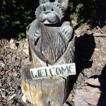 Carved welcome signs in front of each room