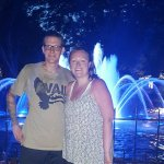 in front of the fountains at night.