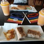 Salmon wrap with mango smoothie & Mediterranean sandwich with also a mango smoothie.