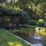 Beautiful garden and very quaint colonial era section of an historic house where Revolutionary B