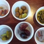 Olives, pickles and olive oil with zatar seasoning