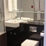 Bathroom sink, commode, and counter