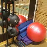 two missing physio balls and no dumbells.  Piled up mats - not clean either.