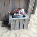Overflowing trash can. Also the sand getting out of control.
