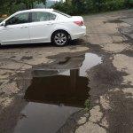 Huge potholes in parking lot