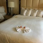 My bed after the cleaning person finished up & left Jelly Bellys & the towel deign