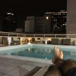 Night time relaxing at the roof top pool after being in the pool