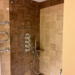 Clean and modern shower/tub.