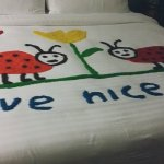 Picture drawn on my bed by my housekeeping using dyed rice grains