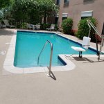 Pool with handicap accessibility chair; chairs but no towels