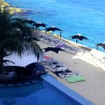 Swim up bar and beach lounge area