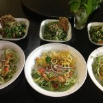 Dinner special being served; spiralized RAW squash dish with kale salad.