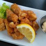 generous portion of chicken karaage (deepfried chicken - boneless). a must have appetizer
