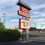 This restaurant is somewhat hidden by vegetation. Look for this sign on the north side of US 10.