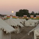 the tent camp under the full moon