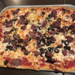 Ground Beef and ripe olive pizza