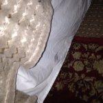 Shower floor, foot marks on sheets