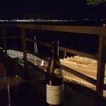 Hanging out on the balcony with a bottle of wine.