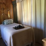 Massage therapy is offered in a calming treatment room.