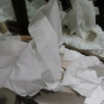 Tissues in the bathroom after the cleaning lady has left the bathroom
