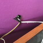 unsafe wiring right next to the bed pillows