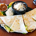 My go to dish: The Chicken Quesadilla. Great sala and lots of sour cream. The black beans are a