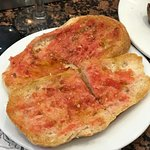 Toasted bread rubbed with tomato and drizzle with olive oil.