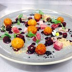 Goats cheese bon bons with beetroot salad hazelnuts and olive crumble