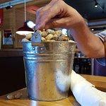 Big bucket of roasted peanuts.