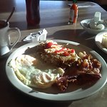Two eggs, hash browns, bacon and pancakes, $7