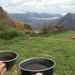 They wake you up with Coca tea outside your tent