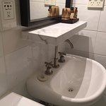 Large shelf over sink means you are unable to lean over to wash your face without banging your h