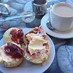 Cream tea. Jam on top on the left scone halves, clotted cream on top on the right scone halves.