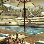 The hotel's outdoor swimming pool, luxury in the water