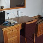 lots of storage space, lamp, info on hotel, hairdryer, tea coffee tv, mirrors