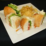 Chicken salad, avocodo, Swiss, lettuce and tomato homemade bread