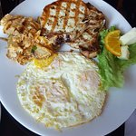 Pork chops with fried eggs and breakfast potatoes at Bistro at the Bijou.