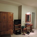 One wardrobe and nice TV with nothing to watch, but with an USB conection.