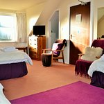 Large family with 4 single beds en-suite. This room is up two flights of stairs . Good views