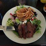 Steak salad, perfectly cooked with sautéed mushrooms, fried onion, radish. $14.